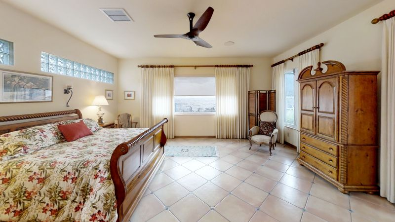Snug-Harbor-Cocoa-Beach-Riverfront-Poolhome-Bedroom(1)